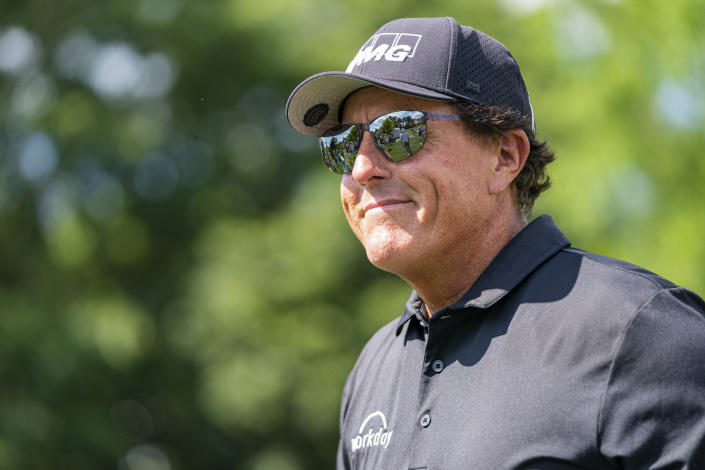 Phil Mickelson smiles to the crowd after the third hole during the first round of the Wells Fargo Championship golf tournament at Quail Hollow on Thursday, May 6, 2021, in Charlotte, N.C. (AP Photo/Jacob Kupferman)