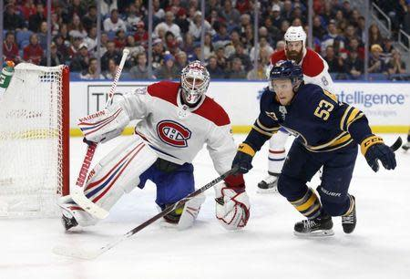 Nov 23, 2018; Buffalo, NY, USA; Montreal Canadiens goaltender Antti Niemi (37) watches as Buffalo Sabres left wing Jeff Skinner (53) goes after a loose puck in overtime at KeyBank Center. Timothy T. Ludwig-USA TODAY Sports