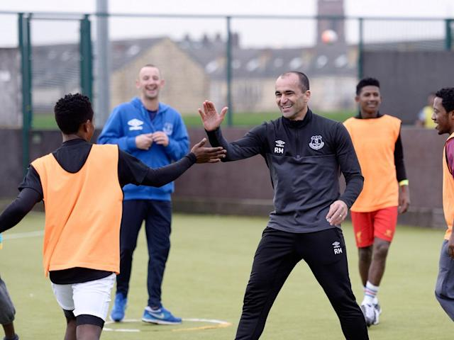 Vieira in training with Martinez at one of Everton's coaching sessions for refugees