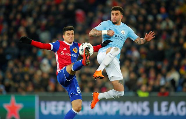 Soccer Football - Champions League - Basel vs Manchester City - St. Jakob-Park, Basel, Switzerland - February 13, 2018 Basel's Mohamed Elyounoussi in action with Manchester City's Kyle Walker REUTERS/Denis Balibouse