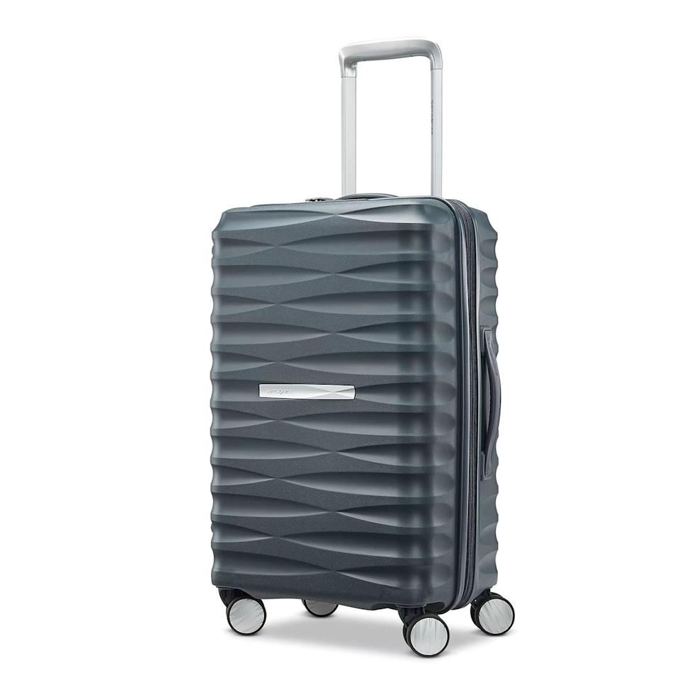 <p>This quality carry-on is lightweight, but at the same time, has an extremely tough polypropylene exterior to withstand every bump and drop. Two more reasons to invest? The TSA-approved lock and the USB port with charging capabilities. Plus, given the fun yet timeless look, it'll no doubt come in handy on trips for years to come.</p>
