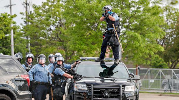 PHOTO: A police officer aims before firing at protestors gathered near the Minneapolis Police third precinct after the death of an African-American man, George Floyd, in Minneapolis, May 27, 2020. (Eric Miller/Reuters)