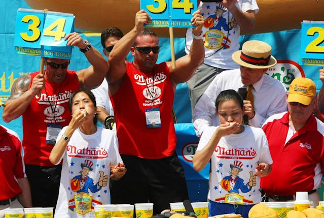 NEW YORK, NY- JULY 04: Juliet Lee (L) and Sonya Thomas compete in the women's division of the Nathan's Famous Fourth of July Hot Dog Eating Contest at Nathan's Famous in Coney Island on July 4, 2013 in the borough of Brooklyn in New York City. Thomas of Alexandria, Virginia, held onto her title after downing 37 hot dogs in ten minutes.(Photo by Monika Graff/Getty Images)