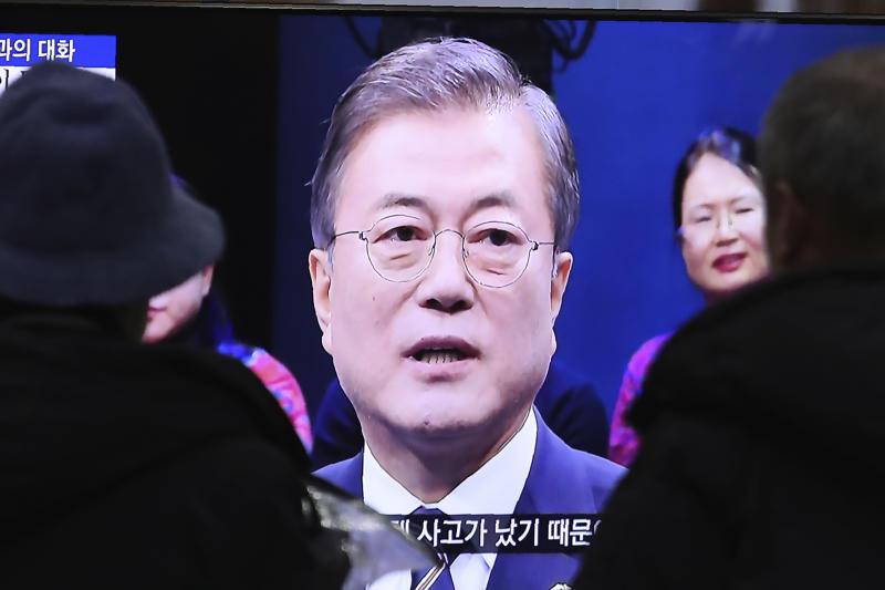 In this Tuesday, Nov. 19, 2019 photo, people watch a TV screen showing a live broadcast of South Korean President Moon Jae-in's speech during a town hall meeting with the public at the Seoul Railway Station in Seoul, South Korea. Moon on Tuesday repeated that Japan's trade curbs, which were based on vague security concerns over South Korea's export controls on sensitive materials, forced Seoul to rethink whether it could keep sharing sensitive military information with a partner that questions its reliability. (AP Photo/Ahn Young-joon)
