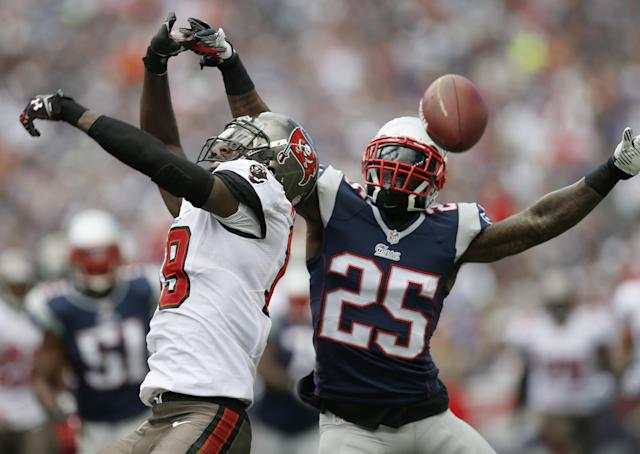 Tampa Bay Buccaneers wide receiver Mike Williams, left, can't catch a pass from quarterback Josh Freeman, as New England Patriots cornerback Kyle Arrington (25) defends in the first half of an NFL football game Sunday, Sept. 22, 2013, in Foxborough, Mass. Arrington was penalized for pass interference on the play. (AP Photo/Elise Amendola)