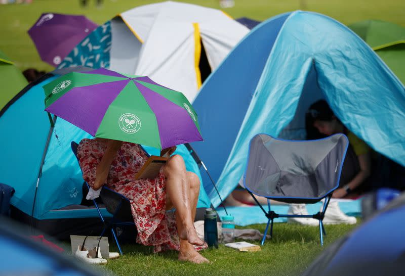 FILE PHOTO: The sight of spectators queueing overnight in tents outside of the Wimbledon grounds will be absent this year as all tickets are being sold online