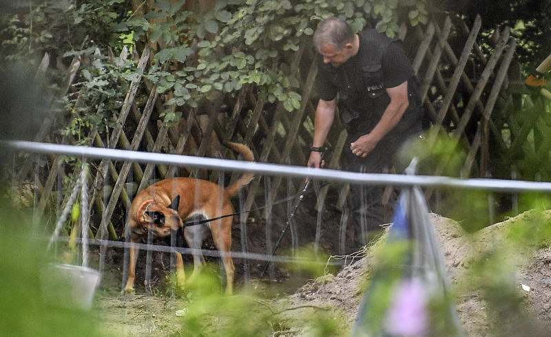 Germany police officers are seen with search dogs. Source: AP