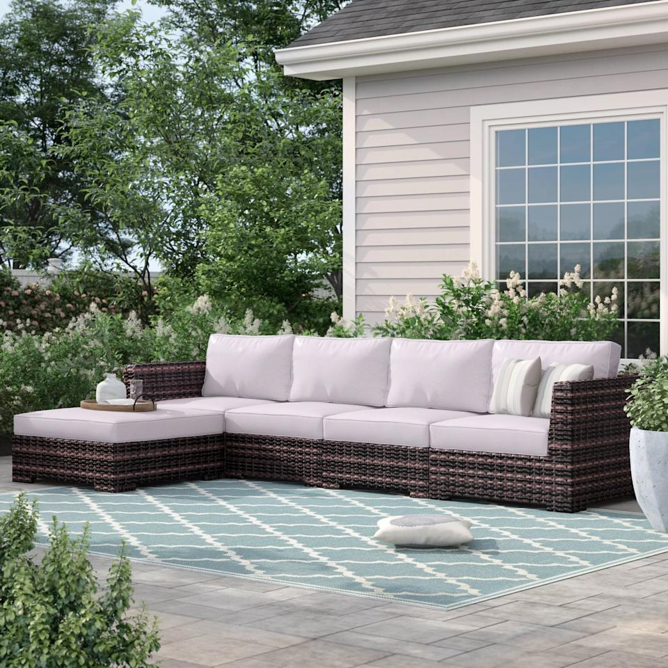 """<p>The length of this <a href=""""https://www.popsugar.com/buy/Sol-72-Outdoor-Letona-Resort-Patio-Sectional-Cushions-582215?p_name=Sol%2072%20Outdoor%20Letona%20Resort%20Patio%20Sectional%20With%20Cushions&retailer=wayfair.com&pid=582215&price=1%2C280&evar1=casa%3Aus&evar9=47551929&evar98=https%3A%2F%2Fwww.popsugar.com%2Fhome%2Fphoto-gallery%2F47551929%2Fimage%2F47551995%2FSol-72-Outdoor-Letona-Resort-Patio-Sectional-With-Cushions&list1=furniture%2Coutdoor%20decorating%2Chome%20shopping&prop13=api&pdata=1"""" rel=""""nofollow"""" data-shoppable-link=""""1"""" target=""""_blank"""" class=""""ga-track"""" data-ga-category=""""Related"""" data-ga-label=""""https://www.wayfair.com/outdoor/pdp/sol-72-outdoor-letona-resort-patio-sectional-with-cushions-w000449516.html"""" data-ga-action=""""In-Line Links"""">Sol 72 Outdoor Letona Resort Patio Sectional With Cushions</a> ($1,280, originally $1,460) is perfect if you have a larger space.</p>"""