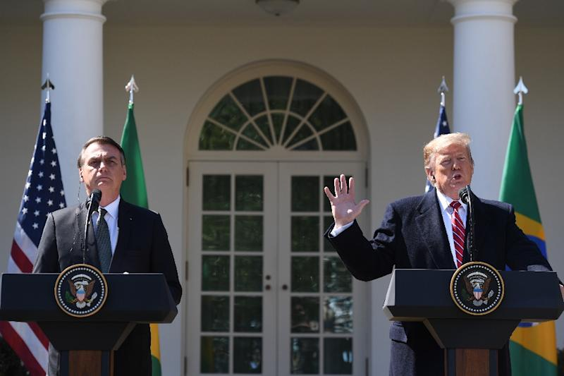 US President Donald Trump speaks during a joint press conference with Brazil's President Jair Bolsonaro in the Rose Garden at the White House