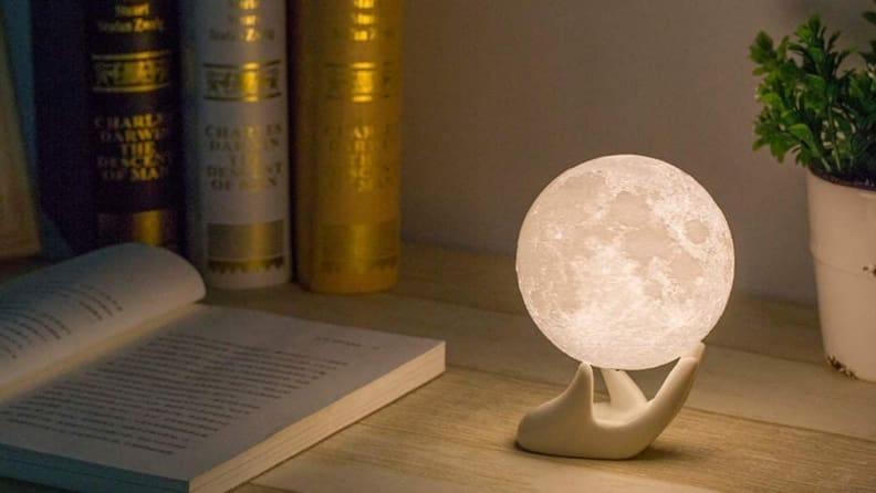 Let the faux moon illuminate your room.