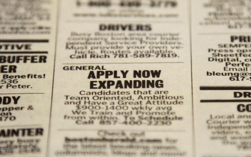 In this Tuesday, Dec. 11, 2012 photo taken in Walpole, Mass., an advertisement in the classified section of the Boston Herald newspaper calls attention to possible employment opportunities. The number of Americans seeking unemployment benefits fell sharply for a fourth straight week, a sign that the job market may be improving. The Labor Department said Thursday, Dec. 13, 2012, that weekly applications for unemployment benefits fell 29,000 last week to a seasonally adjusted 343,000, the lowest in two months. It is the second-lowest total this year. (AP Photo/Steven Senne)