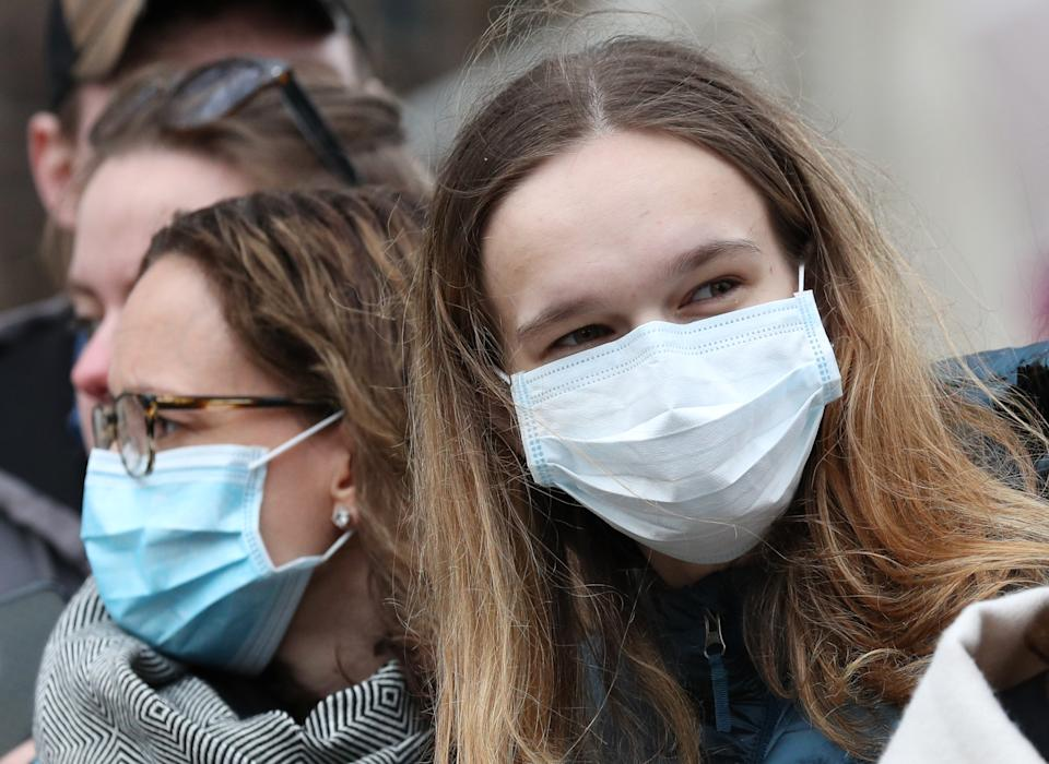 Spectators wearing masks to protect against coronavirus outside the Commonwealth Service at Westminster Abbey, London on Commonwealth Day. The service is the Duke and Duchess of Sussex's final official engagement before they quit royal life.