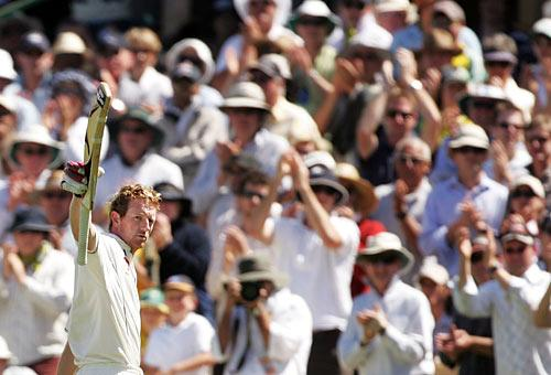 Paul Collingwood raises his bat to the crowd after falling for 206