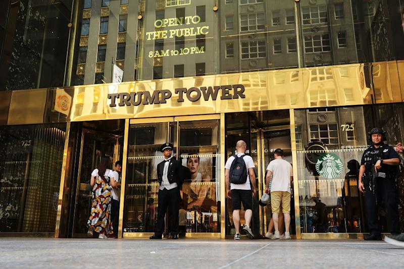 People walk by Trump Tower on Fifth Avenue in Manhattan on August 24, 2018 in New York. | Spencer Platt—Getty Images