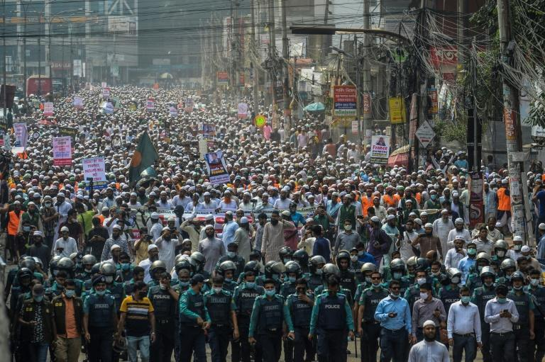 Protesters in Dhaka set alight an effigy of Macron during Tuesday's march