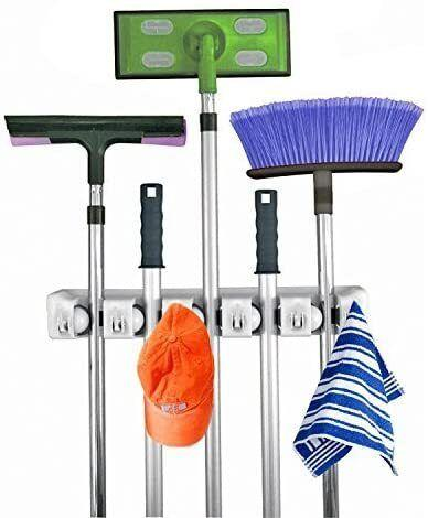 """It'llbecome your cleaning station with five spots for long-handed tools and six hooks to help corral product bottles.<br /><br /><strong>Promising review:</strong>""""Perfect! Exactly what I needed to organize my mop, broom, scoop, etc. Efficient and easy to use. A little hard to get my scoop into it but that's cause it's thicker than the rest of items.<strong>Love that there are hooks.</strong>Spray bottles and cleaning product bottles hang perfectly on there too."""" — <a href=""""https://www.amazon.com/gp/customer-reviews/R15T5BUNAARTIA?&linkCode=ll2&tag=huffpost-bfsyndication-20&linkId=ababf7809e9c4e4ad1bc1f77b17768ef&language=en_US&ref_=as_li_ss_tl"""" target=""""_blank"""" rel=""""noopener noreferrer"""">Kavita Chandanie</a><br /><br /><strong><a href=""""https://www.amazon.com/Home-position-solutions-organizer-shelving/dp/B00EJU3SWY?&linkCode=ll1&tag=huffpost-bfsyndication-20&linkId=649728da9628a822c81288362ca8bba6&language=en_US&ref_=as_li_ss_tl"""" target=""""_blank"""" rel=""""noopener noreferrer"""">Get it from Amazon for $13.99.</a></strong>"""