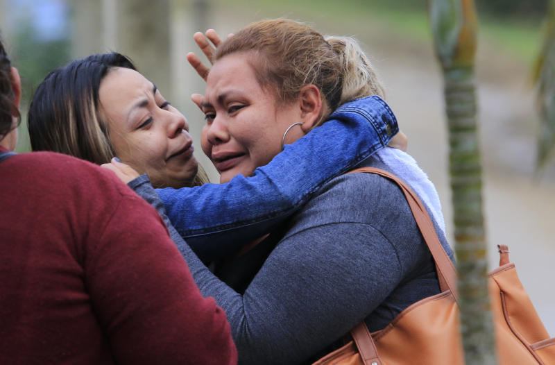 Family members cry as they wait for news from their imprisoned relatives, outside the Tela prison where at least 18 inmates were killed during a riot on Friday, in Tela, Honduras, Saturday, Dec. 21, 2019. The riot came several days after Honduras declared a state of emergency in its prison system. (AP Photo/Delmer Martinez)