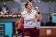 Aryna Sabalenka of Belarus celebrates a point during the women's final match against Australia's Ashleigh Barty at the Mutua Madrid Open tennis tournament in Madrid, Spain, Saturday, May 8, 2021. (AP Photo/Bernat Armangue)