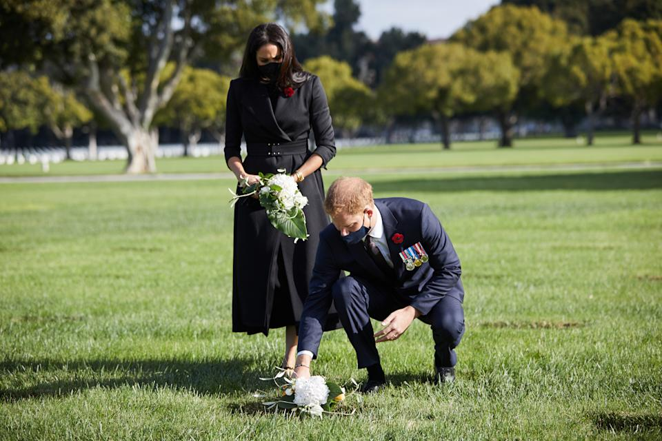 Prince Harry and Meghan Markle laying flowers on Remembrance Day