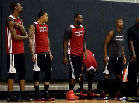 (left to right) Miami Heat center Chris Bosh (1) forward Michael Beasley (8) forward LeBron James (6) and guard Ray Allen (34) during practice before game 2 of the 2014 NBA Finals at Spurs Practice Facility. Mandatory Credit: Bob Donnan-USA TODAY Sports