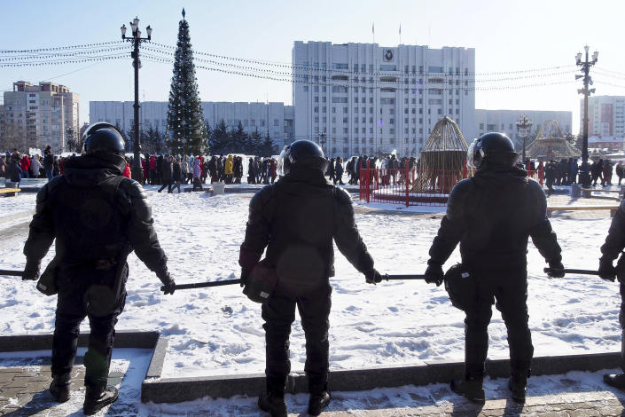 FILE - In this Jan. 23, 2021, file photo, riot police block the square as people gather to protest against the jailing of opposition leader Alexei Navalny in Khabarovsk, east of Moscow, Russia. Allies of Navalny are calling for new protests next weekend to demand his release, following a wave of demonstrations across the country that brought out tens of thousands in a defiant challenge to President Vladimir Putin. (AP Photo/Igor Volkov, File)