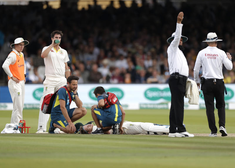 Smith is assessed by Australian Team Doctor after he was struck by a delivery from Jofra Archer. (Photo by Ryan Pierse/Getty Images)