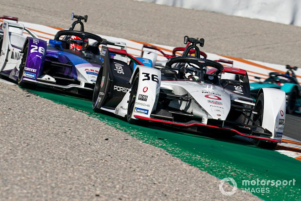 """Andre Lotterer, Tag Heuer Porsche, Porsche 99X Electric, Maximilian Gunther, BMW I Andretti Motorsports, BMW iFE.21<span class=""""copyright"""">Malcolm Griffiths / Motorsport Images</span>"""