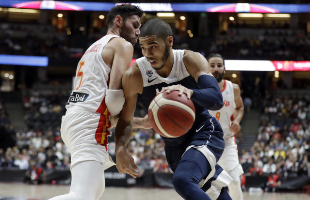 United States' Jayson Tatum, right, is defended by Spain's Rudy Fernandez during the second half of an exhibition basketball game Friday, Aug. 16, 2019, in Anaheim, Calif. (AP Photo/Marcio Jose Sanchez)