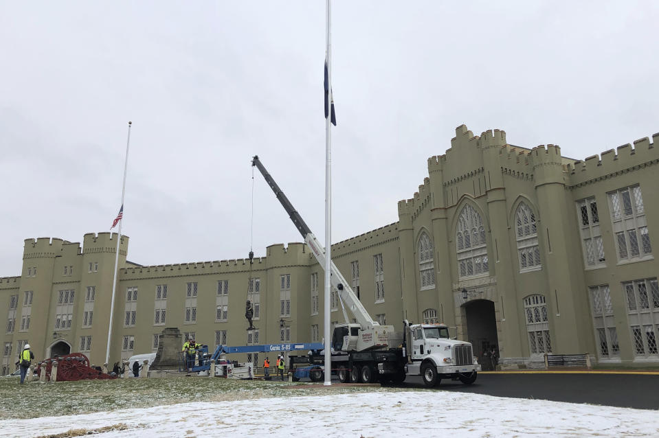 """FILE - Crews lift a statue of Confederate Gen. Thomas """"Stonewall"""" Jackson from its pedestal on the campus of the Virginia Military Institute in Lexington, Va., in this Dec. 7, 2020, file photo. The findings of a months-long investigation into racism at the nearly two-century old Virginia Military Institute will be released Tuesday, June 12, 2021, according to the State Council of Higher Education for Virginia. (AP Photo/Sarah Rankin, File)"""