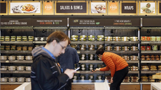 The Amazon employees-only Amazon Go store in Seattle uses a tracking system with sensors and cameras to determine what a customer has bought without anyone ever having to scan an item. Source: AP Photo/Elaine Thompson, File