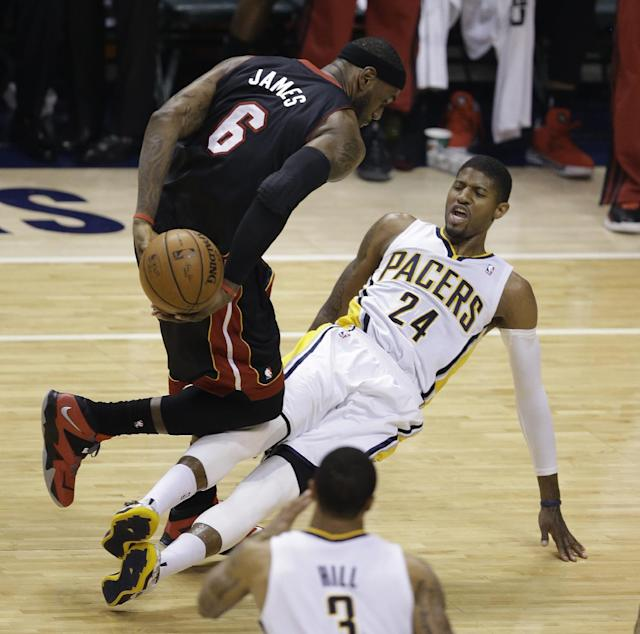 Miami Heat's LeBron James (6) collides with Indiana Pacers' Paul George during the first half of Game 5 of the Eastern Conference finals NBA basketball playoff series Wednesday, May 28, 2014, in Indianapolis. James was called for a foul. (AP Photo/Darron Cummings)