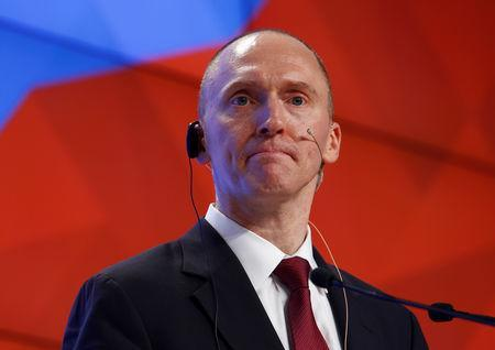 FILE PHOTO: Carter Page addresses the audience during a presentation in Moscow, Russia, December 12, 2016. REUTERS/Sergei Karpukhin