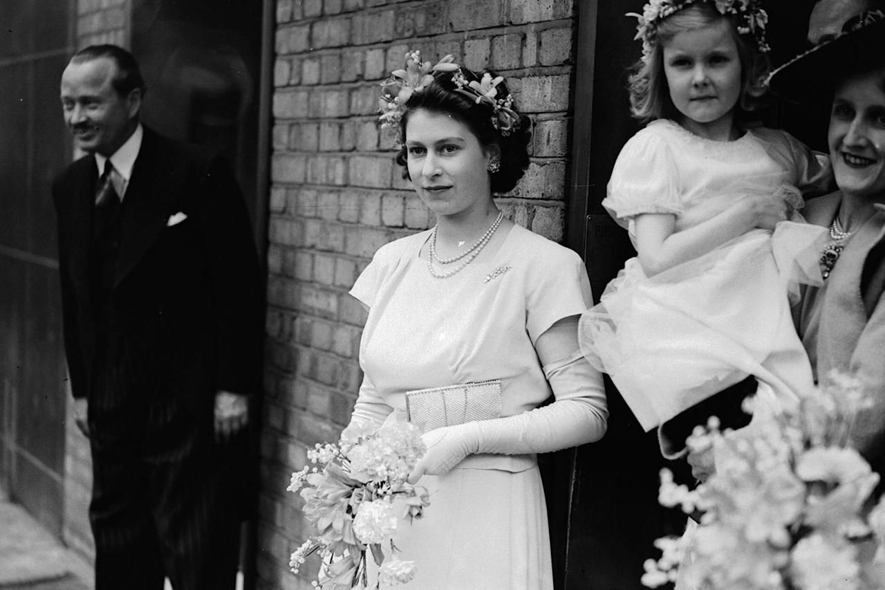 <p>Princess Elizabeth serving as bridesmaid at the wedding of Hon. Mrs. Vicary Gibbs and Captain Hon. A.G.V. Elphinstone.</p>