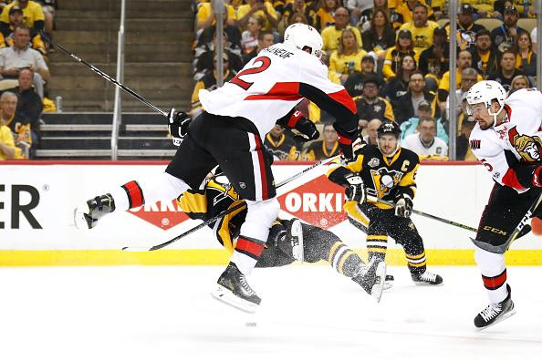 PITTSBURGH PA- MAY 15 Dion Phaneuf #2 of the Ottawa Senators hits Bryan Rust #17 of the Pittsburgh Penguins during the first period in Game Two of the Eastern Conference Final during the 2017 NHL Stanley Cup Playoffs at PPG PAINTS Arena