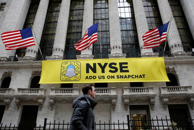 FILE PHOTO: A Snapchat sign hangs on the facade of the NYSE in New York City
