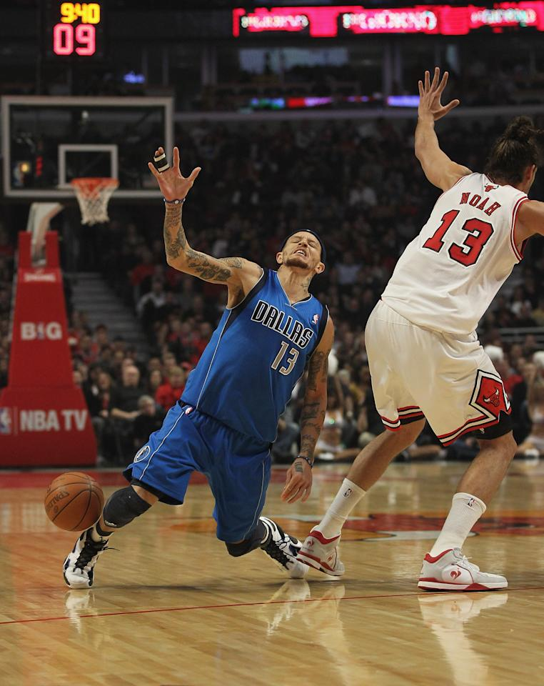 CHICAGO, IL - APRIL 21: Delonte West #13 of the Dallas Mavericks looses the ball after running into Jaokim Noah #13 of the Chicago Bulls at the United Center on April 21, 2012 in Chicago, Illinois. NOTE TO USER: User expressly acknowledges and agress that, by downloading and/or using this photograph, User is consenting to the terms and conditions of the Getty Images License Agreement. (Photo by Jonathan Daniel/Getty Images)