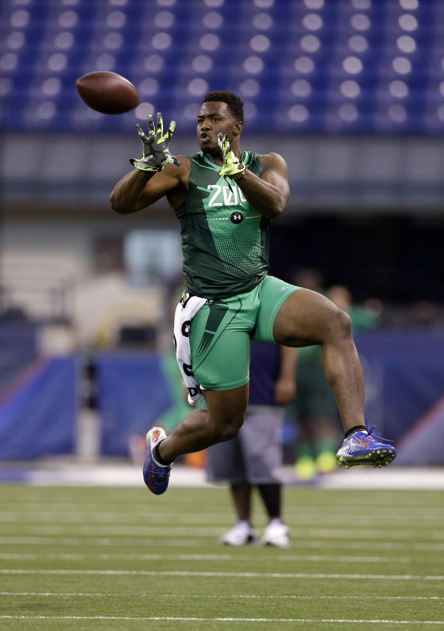 Florida defensive lineman Dante Fowler runs a drill at the NFL football scouting combine in Indianapolis, Sunday, Feb. 22, 2015. (AP Photo/David J. Phillip)