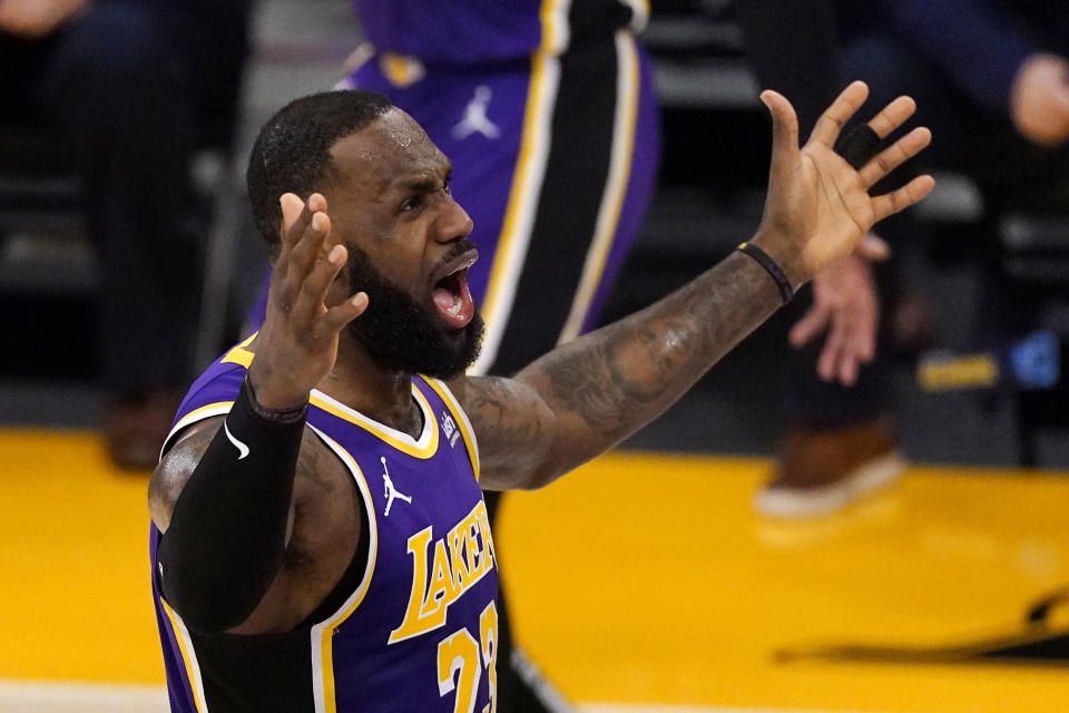 Los Angeles Lakers forward LeBron James complains about the lack of a foul call during the first half of the team's NBA basketball game against the Memphis Grizzlies on Friday, Feb. 12, 2021, in Los Angeles. (AP Photo/Mark J. Terrill)