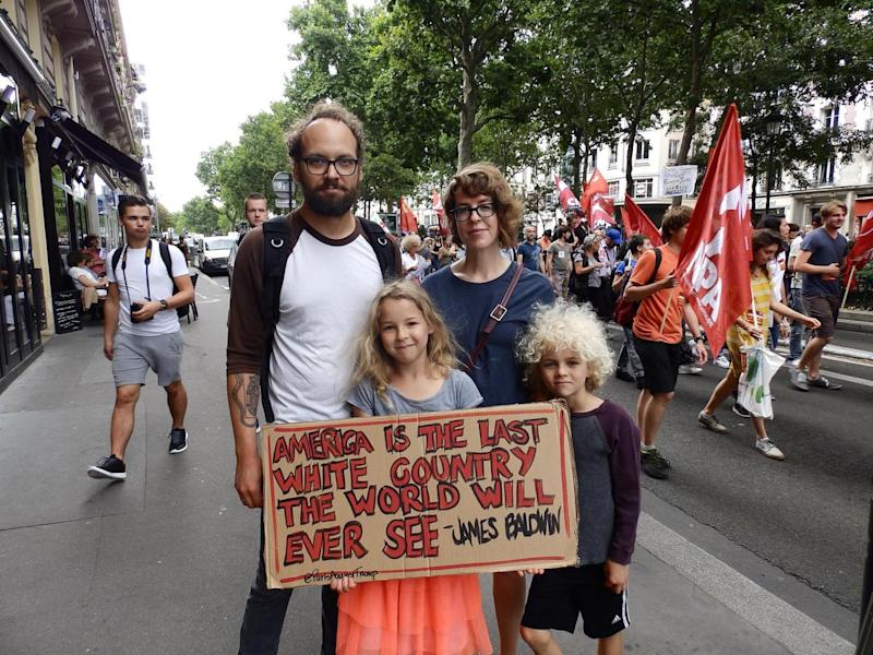 American family Benjamin Paloff, Meg Thomas and their children Breina, nine, and Zeke, seven, at the Bastille Day march in Paris (Lizzie Dearden)