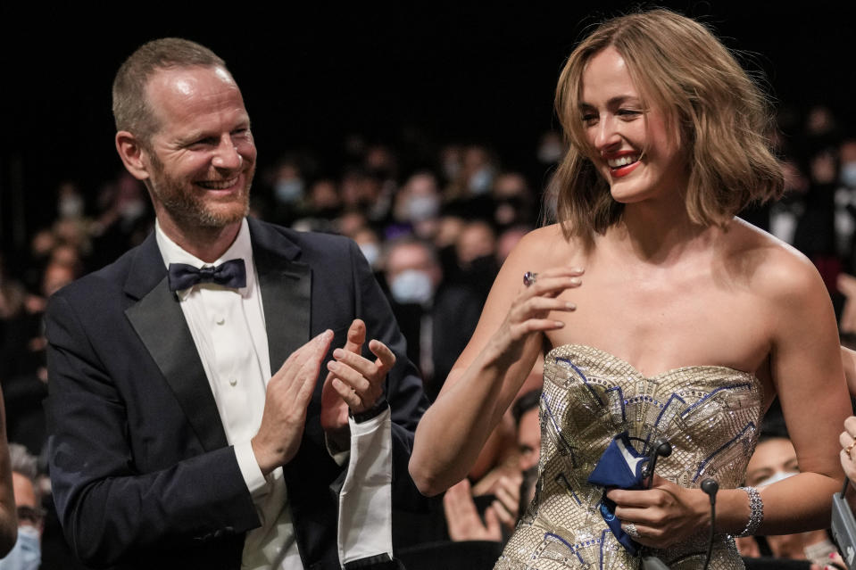 Joachim Trier, left, and Renate Reinsve, winner of the award for best actress for the film 'The Worst Person in The World' appear in the audience during the awards ceremony at the 74th international film festival, Cannes, southern France, Saturday, July 17, 2021. (AP Photo/Vadim Ghirda)