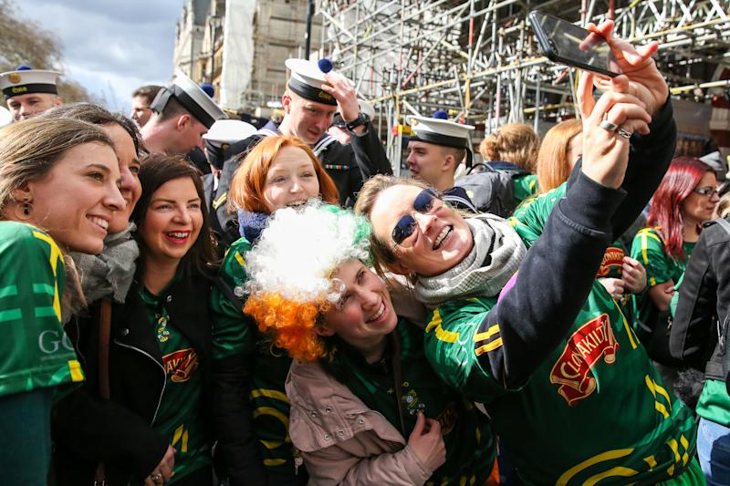 People are seen taking a selfie during the St Patrick's Day celebration as the annual parade travels through the streets of central London. (Photo by Dinendra Haria / SOPA Images/Sipa USA)