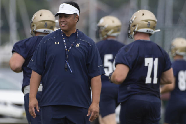 Navy head coach Ken Niumatalolo helped present his son a scholarship at Utah. (AP Photo/Tommy Gilligan)