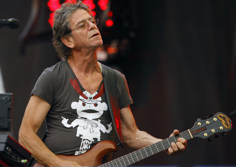 """FILE- In this Sunday, Aug. 9, 2009 file photo, Lou Reed performs at the Lollapalooza music festival, in Chicago. Lou Reed's wife says the rock icon is recovering after a life-saving liver transplant, according to an interview published Saturday, June 1, 2013, in a British newspaper. Laurie Anderson told the Times of London that Reed """"was dying"""" before the operation in April at Ohio's Cleveland Clinic. (AP Photo/John Smierciak, File)"""
