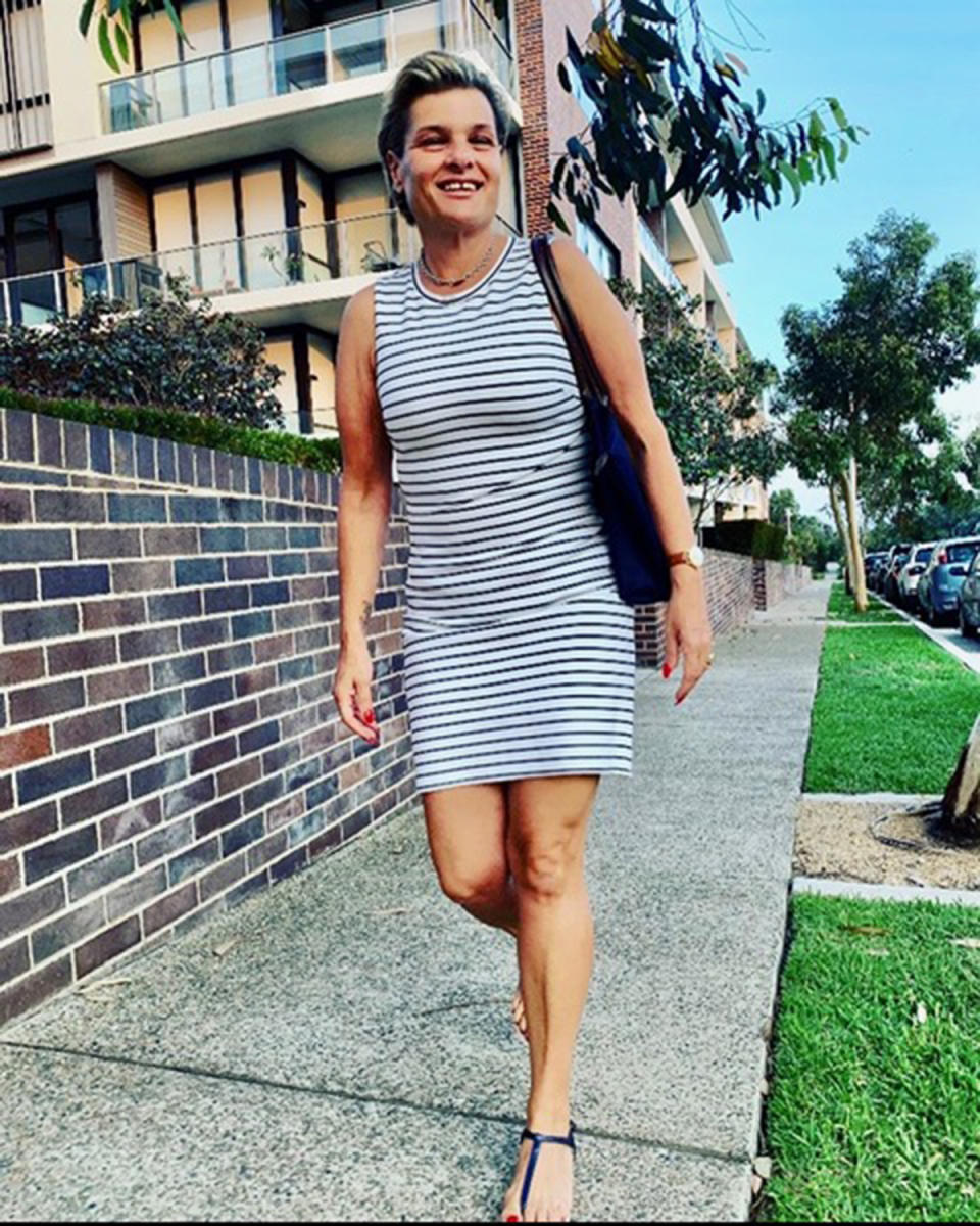 A photo of Sydney woman Maria wearing a black and white striped dress