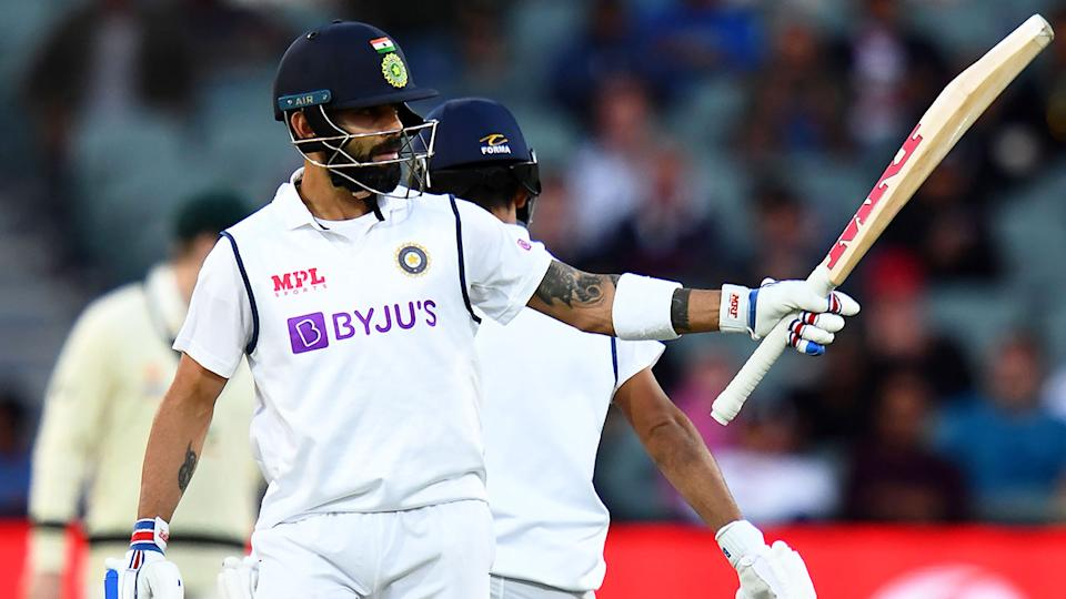 Pictured here, India captain Virat Kohli salutes after making a half century in Adelaide.