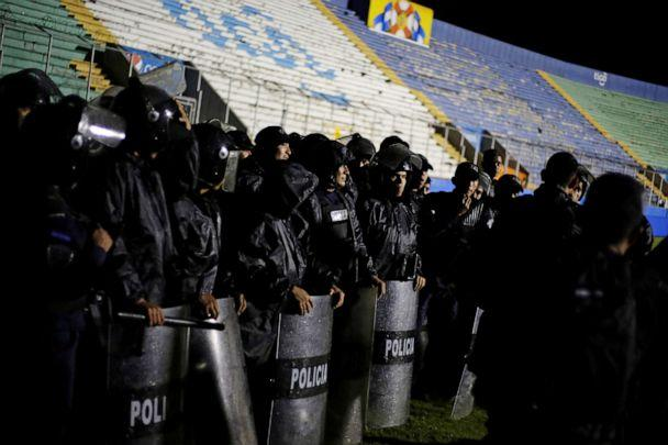 PHOTO: Police officers keep watch after three people died in riots before a soccer match when the fans attacked a bus carrying one of the teams, inside the National Stadium in Tegucigalpa, Honduras, on Saturday, Aug. 17, 2019. (Jorge Cabrera/Reuters)