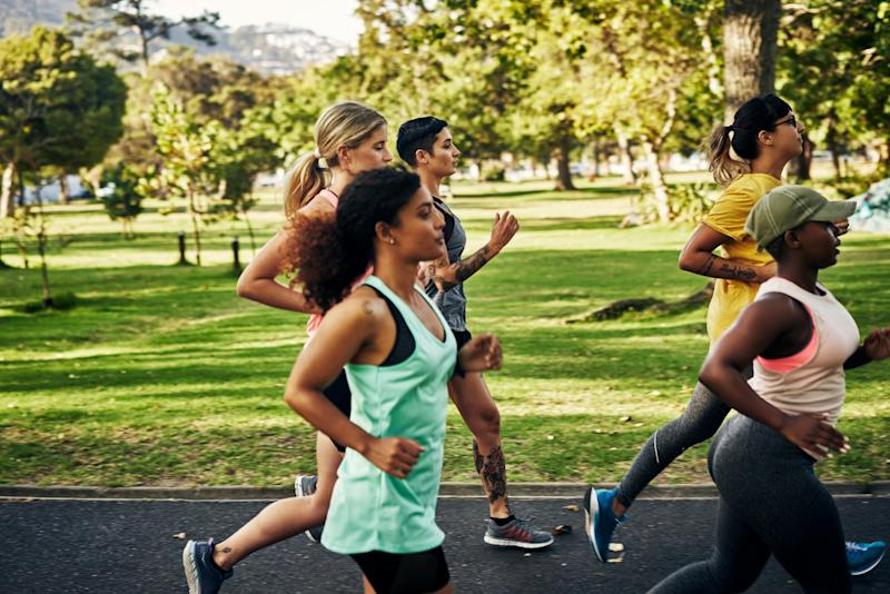 Shot of a group of young women going for a run in the park