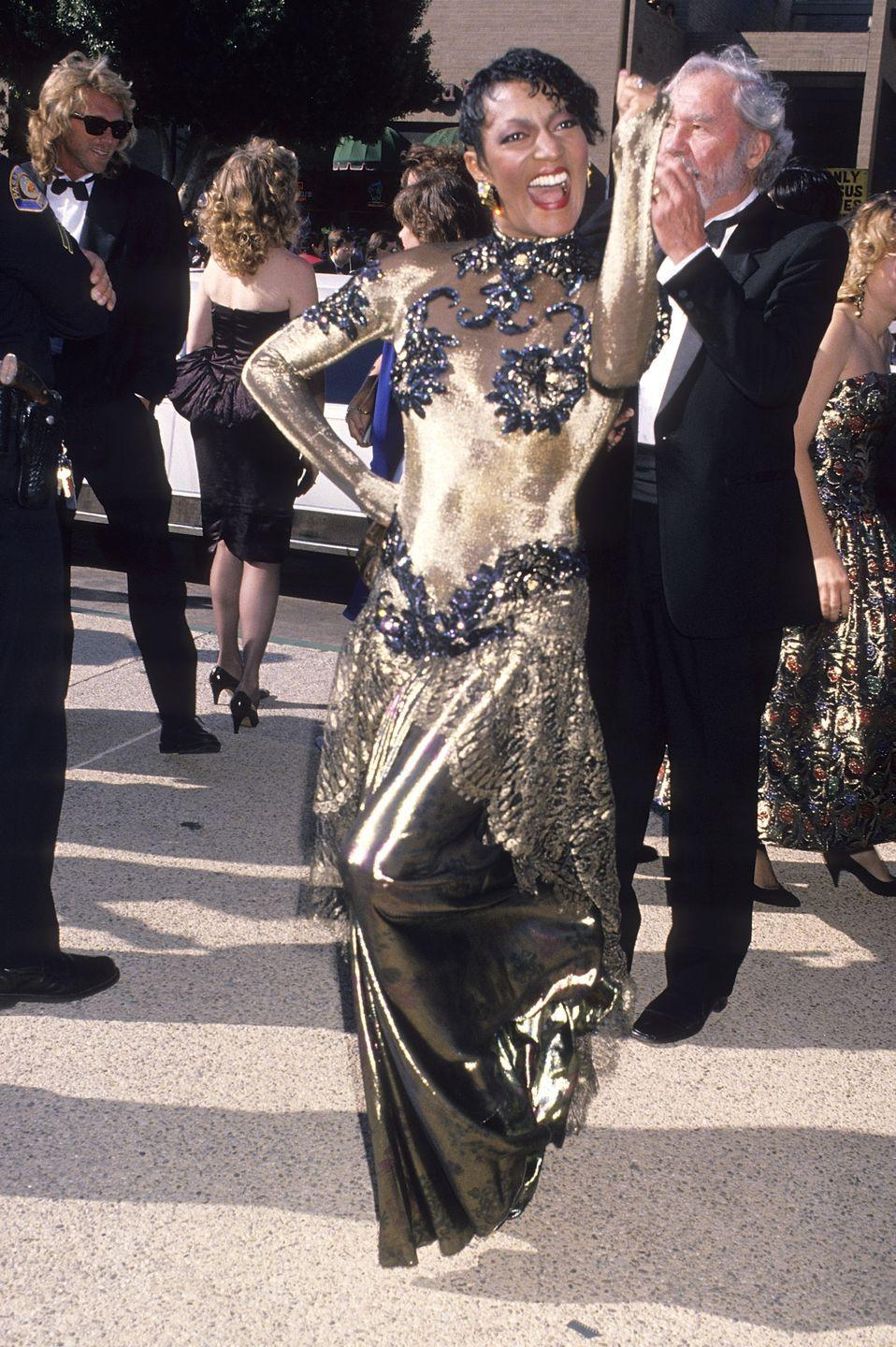 """<p>The """"Night Court"""" actor appeared in a shimmering, golden metallic dress, and showed it off enthusiastically.</p>"""
