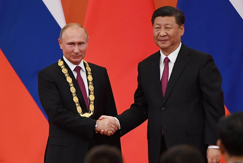 Putin and Xi have forged closer ties as US President Donald Trump has labelled both countries economic rivals (AFP Photo/Greg Baker)