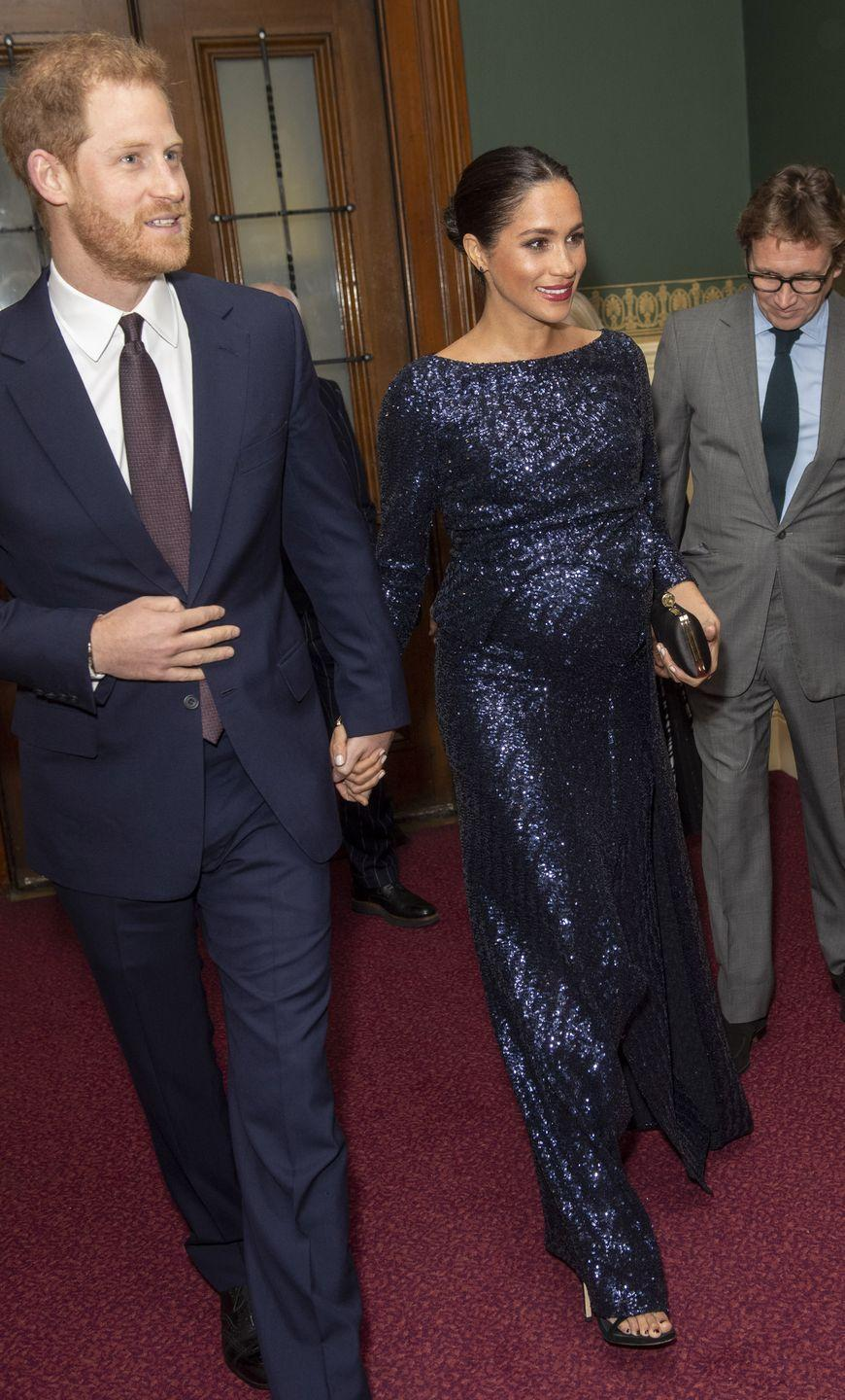 "<p>Meghan and Harry attended the premiere of Cirque du Soleil's newest show, Totem, to benefit Sentebale in London. The Duchess <a href=""https://www.townandcountrymag.com/style/fashion-trends/a25903852/meghan-markle-cirque-du-soleil-sentebale-dress-roland-mouret/"" rel=""nofollow noopener"" target=""_blank"" data-ylk=""slk:wore a sequin gown by Roland Mouret"" class=""link rapid-noclick-resp"">wore a sequin gown by Roland Mouret </a>with a Givenchy clutch and <a href=""https://go.redirectingat.com/?id=74968X1525087&xs=1&url=https%3A%2F%2Fwww.stuartweitzman.com%2Fproducts%2Fnudist%2Fblack-suede%2F&sref=https%3A%2F%2Fwww.townandcountrymag.com%2Fstyle%2Ffashion-trends%2Fa25903852%2Fmeghan-markle-cirque-du-soleil-sentebale-dress-roland-mouret%2F"" rel=""nofollow noopener"" target=""_blank"" data-ylk=""slk:black suede heels by Stuart Weitzman"" class=""link rapid-noclick-resp"">black suede heels by Stuart Weitzman</a>. </p>"
